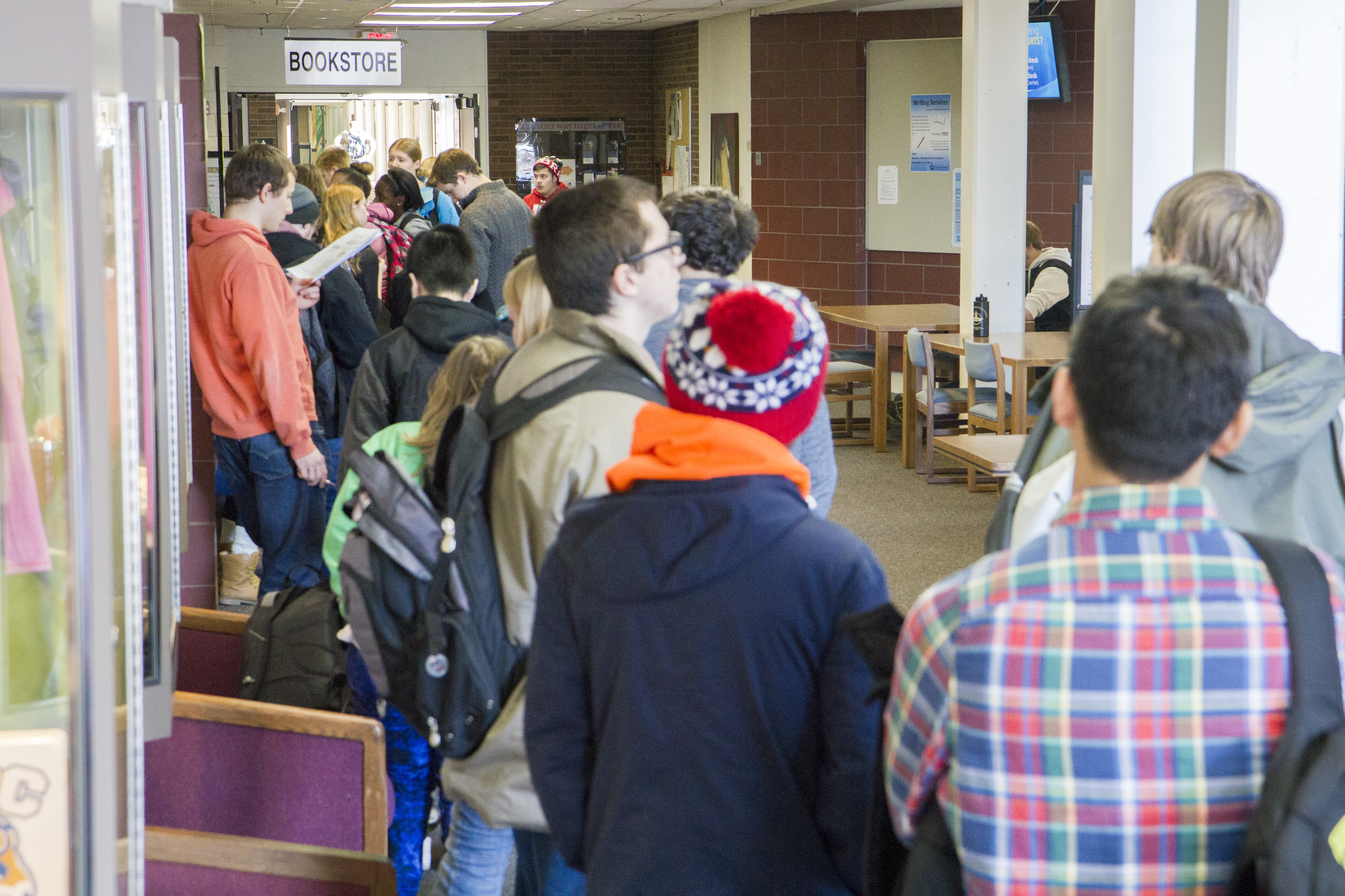 Students wait in line for books at the Campus Store in January 2016. Bookstore frustrations continue for students today.
