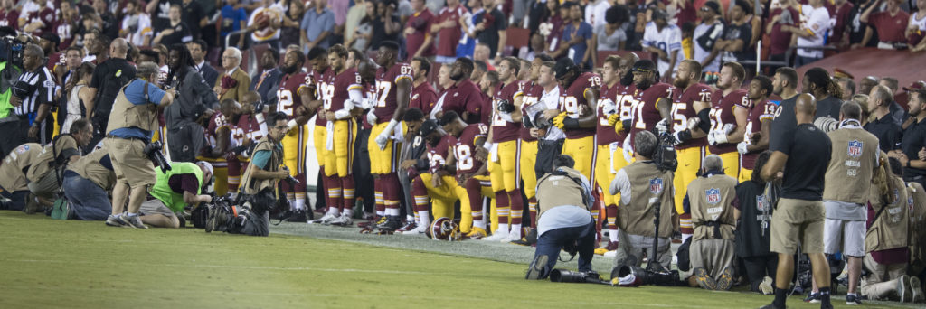 Some+players+kneel+in+protest+during+the+National+Anthem+while+others+stand.