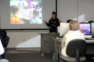 Greta McLain embellishes on a point in her presentation to a captivated audience.
