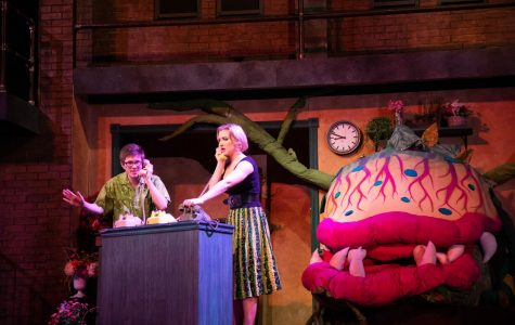 "Left to right: Logan Douglas, Sara Kuntz, and Glen Lee (inside the plant) performing during a dress rehearsal for ""Little Shop of Horrors."""