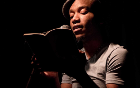 Donte Collins reads their poetry on stage. Image supplied by Collins.