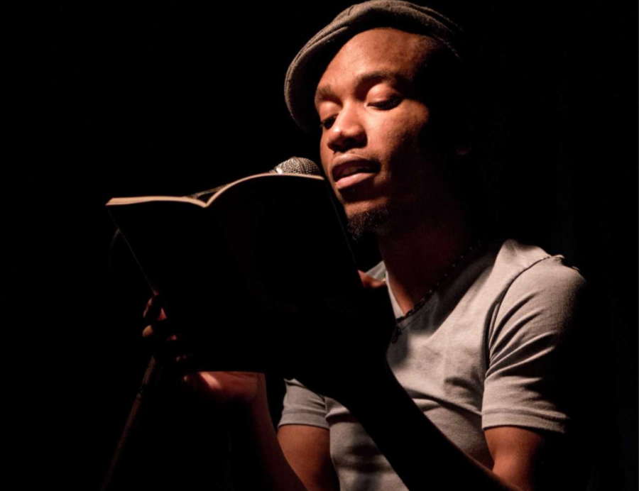 Donte+Collins+reads+their+poetry+on+stage.+Image+supplied+by+Collins.+