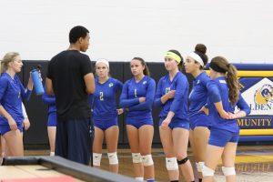 Coach Bader talking to the Anoka-Ramsey volleyball team. Image courtesy of Anoka-Ramsey Athletics.