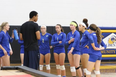 Coach Bader talking to the Anoka-Ramsey volleyball team. Image courtesy of Anoka-Ramsey Athletics.