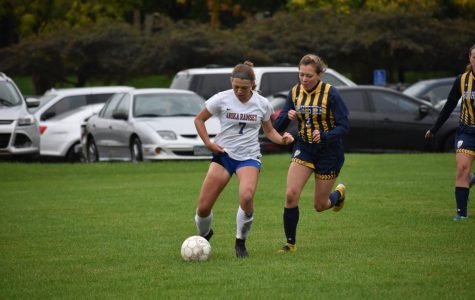 Lauren Ives moves past Rochester player during their regular season game, held at home on Oct. 2.