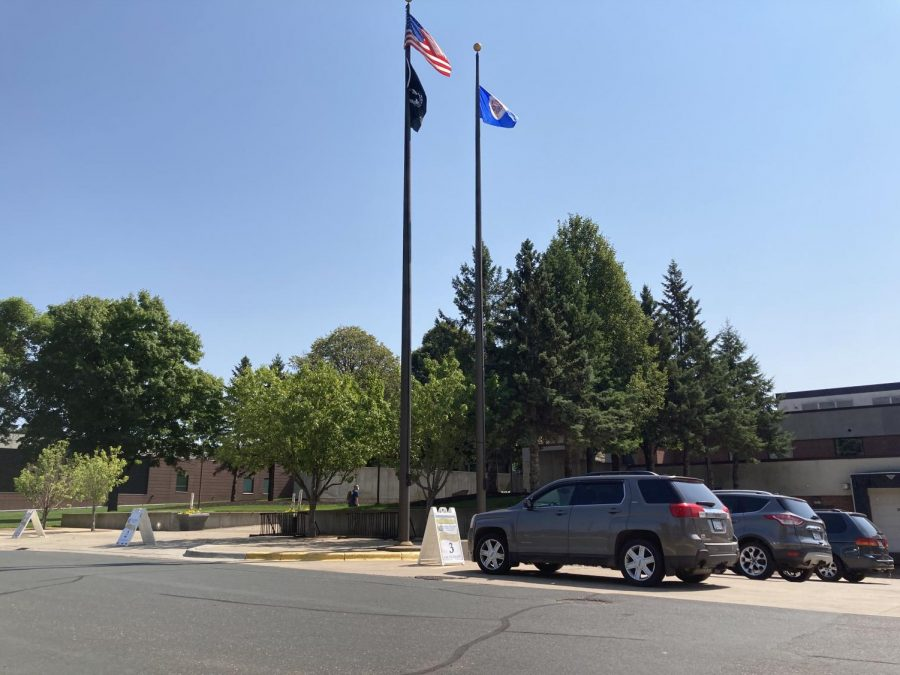 Cars parked next to a flagpole